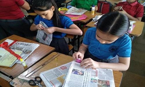 Making Newspaper bags 1